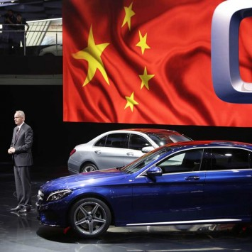 Troska, Daimler board member responsible for greater China, attends a world premiere ceremony for the new Mercedes Benz C-Class Long Wheelbase at Auto China 2014 in Beijing