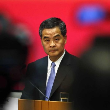 Hong Kong Chief Executive Leung Chun-ying looks on in between video cameras during a news conference in Hong Kong