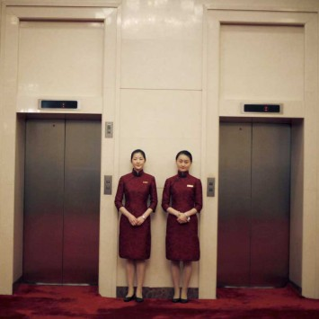 Chinese attendants wait outside the hall where U.S. Deputy Secretary of State James Steinberg is speaking with Chinese Vice President Xi JinPing in Beijing
