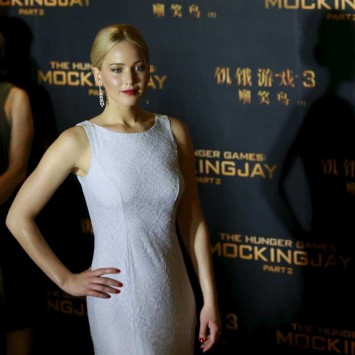 """Cast member Jennifer Lawrence poses at a red carpet event for the China premiere of """"The Hunger Games: Mockingjay - Part 2"""" in Beijing"""