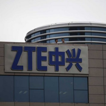 Employees of ZTE chat on the roof of its headquarters in Shenzhen, Guangdong province