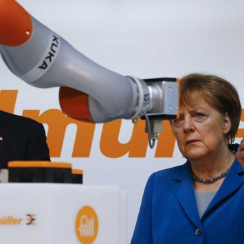 U.S. President Obama and German Chancellor Merkel watch the work of KUKA robot during their tour at the Hannover Messe in Hanover