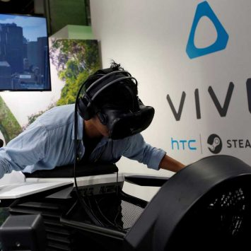 A visitor tries the flight simulator Birdly with a pair of HTC's Vive Virtual Reality (VR) goggles, during the annual Computex computer exhibition in Taipei